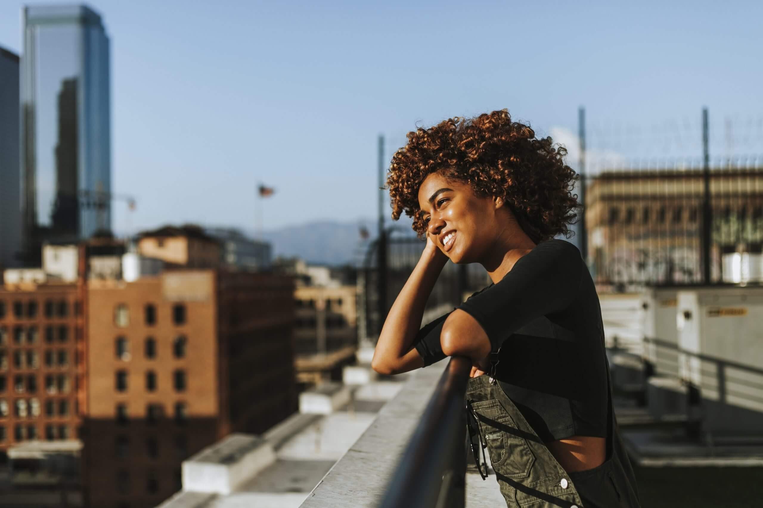 Girl standing on balcony